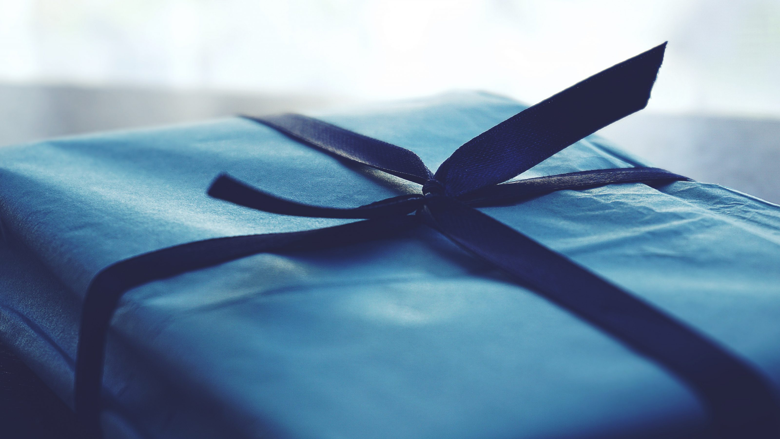 close-up-photo-of-tied-blue-box-1178562